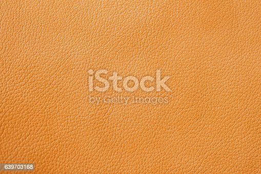 istock Texture of genuine leather close-up, cowhide, orange, for background 639703168