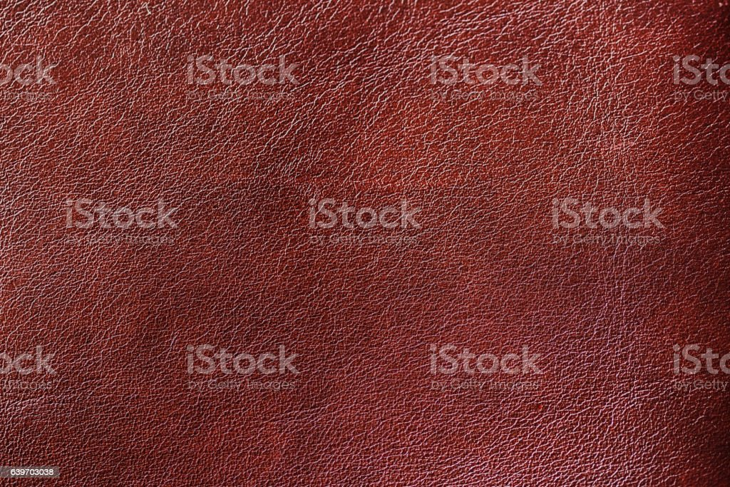 Texture of Genuine Leather shiny, antique, cracked, ,maroon color, background stock photo