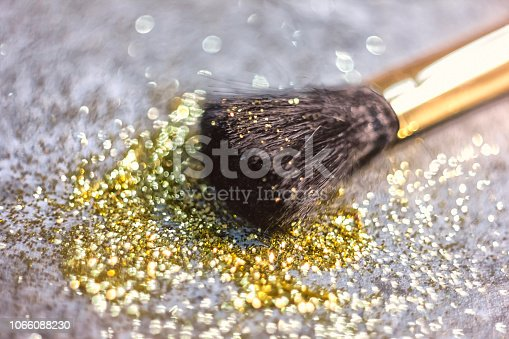 istock texture of gold glitter on the makeup brush and design 1066088230