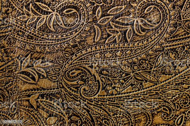 Texture of golden brown genuine leather closeup with embossed floral picture id1076572112?b=1&k=6&m=1076572112&s=612x612&h=hlcwtih1f15vxcx652xalvc2gklxkqsyvpe5s vr5p4=