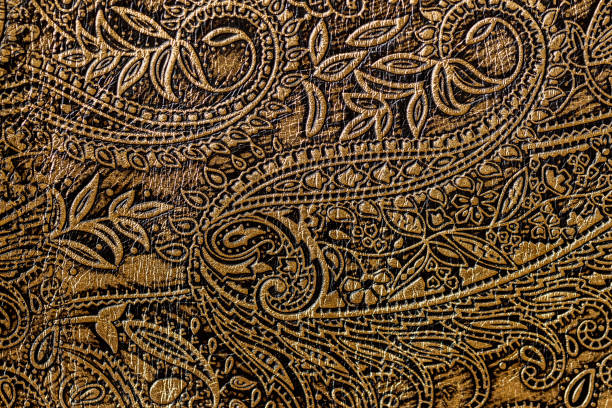 texture of golden brown genuine leather close-up, with embossed floral trend pattern, wallpaper or banner design - west direction stock pictures, royalty-free photos & images