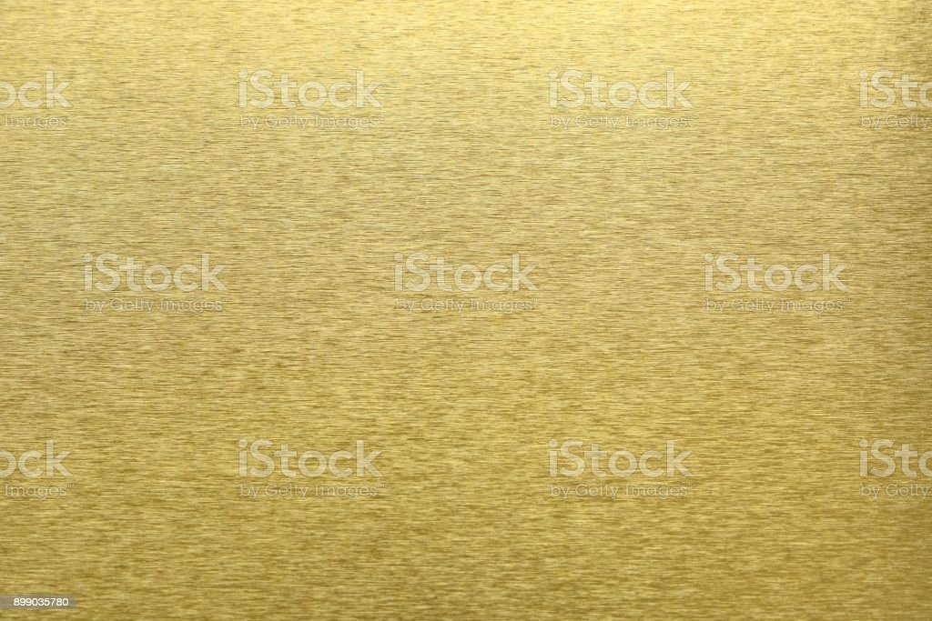 Texture of golden metal, abstract pattern background, selective focus stock photo