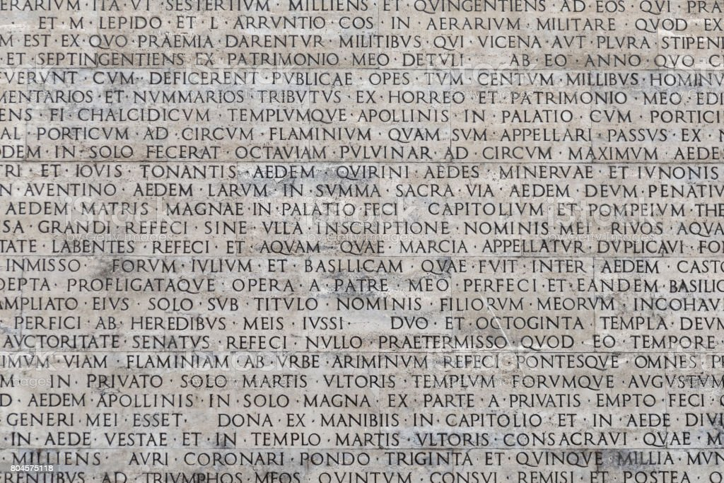 Texture of latin words engraved on a marble plaque stock photo