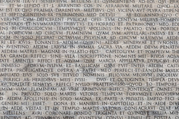 Texture of latin words engraved on a marble plaque Texture of latin words engraved on a marble plaque greco roman style stock pictures, royalty-free photos & images