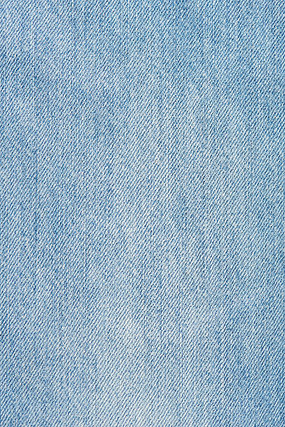 Texture of light blue jeans stock photo