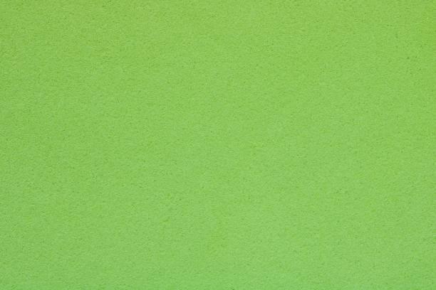 textur des hellen grünen schwamm, abstrakten hintergrund - kunststoff farbe stock-fotos und bilder