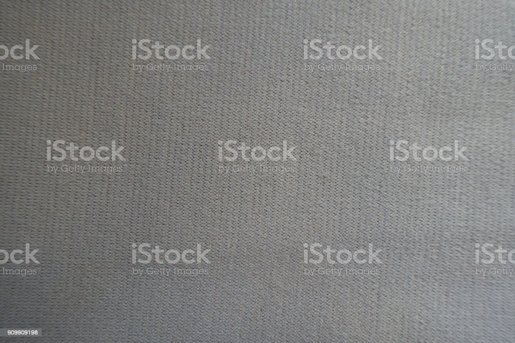 Texture of light grey jersey fabric from above stock photo