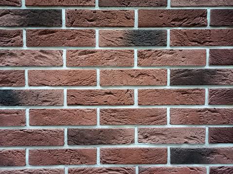 Red brick wall texture grunge background, interior design