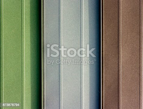 687475318 istock photo Texture of metal shingles close-up 873878794