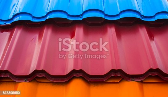 687475318 istock photo Texture of metal shingles close-up 873895550