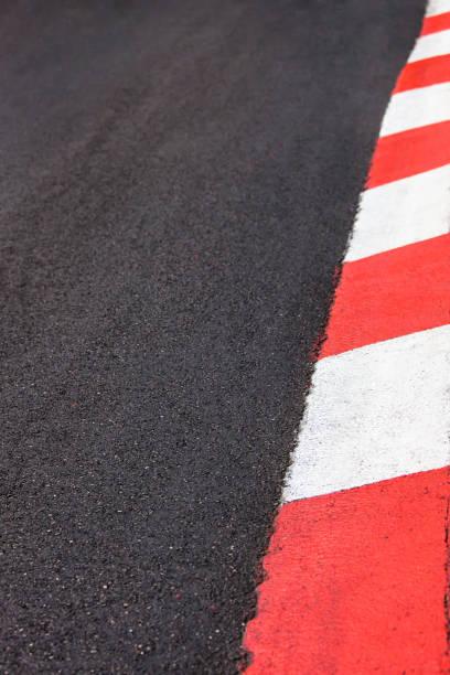 texture of motor race asphalt and curb grand prix circuit - formula 1 стоковые фото и изображения