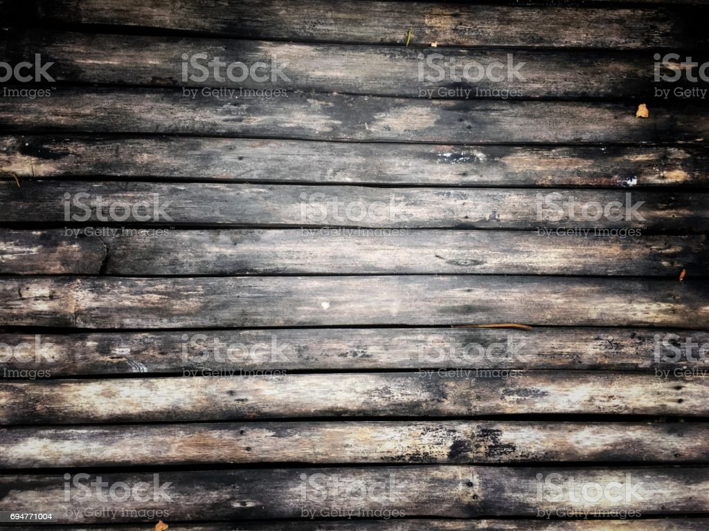 texture of Natural old dry bamboo wall, gate for background, with vintage tine and soft black border effect. stock photo