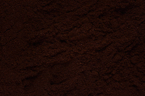 texture of not smooth surface of dark ground coffee background for design stock photo