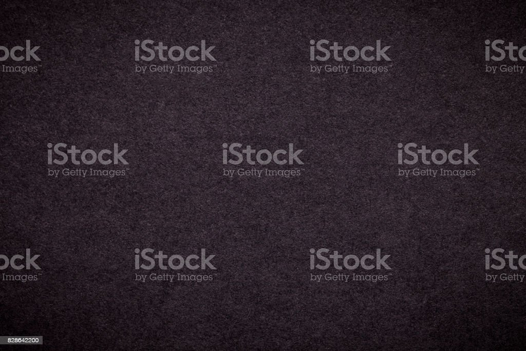 Texture of old dark brown paper background, closeup. Structure of dense black cardboard stock photo
