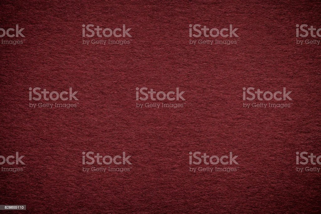 Texture of old dark red paper background, closeup. Structure of dense maroon cardboard - foto stock