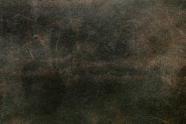 Texture of old genuine leather, scuffs and scratches stock photo