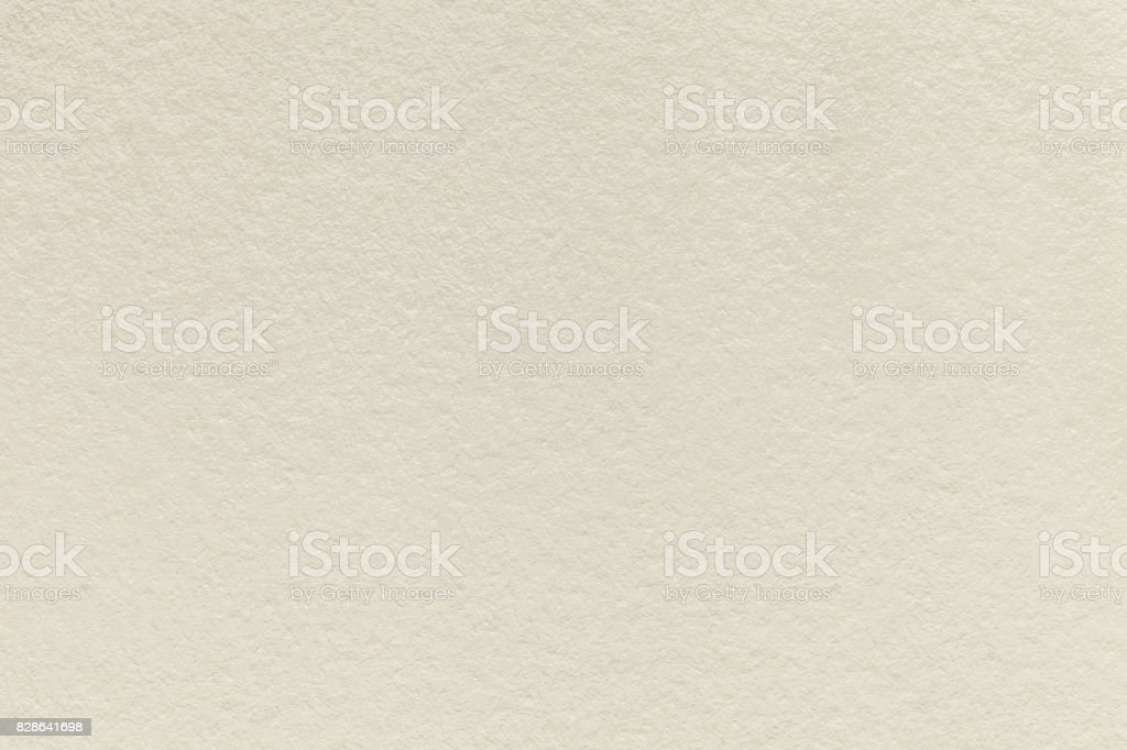 Texture of old light beige paper background, closeup. Structure of dense sand cardboard - foto stock