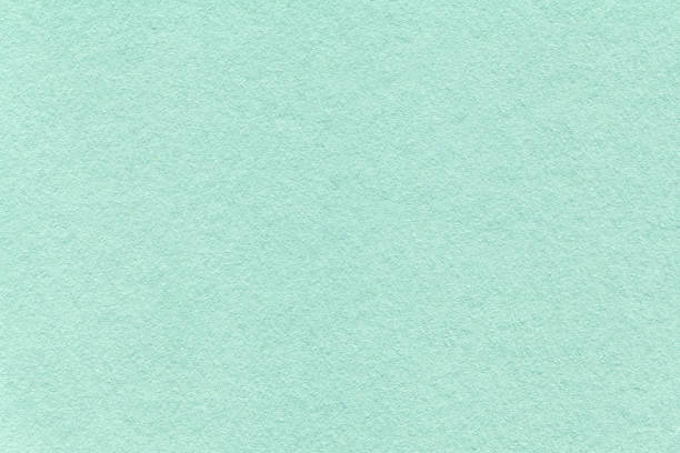 texture of old light cyan paper background, closeup. structure of dense turquoise cardboard - pastel colored stock pictures, royalty-free photos & images