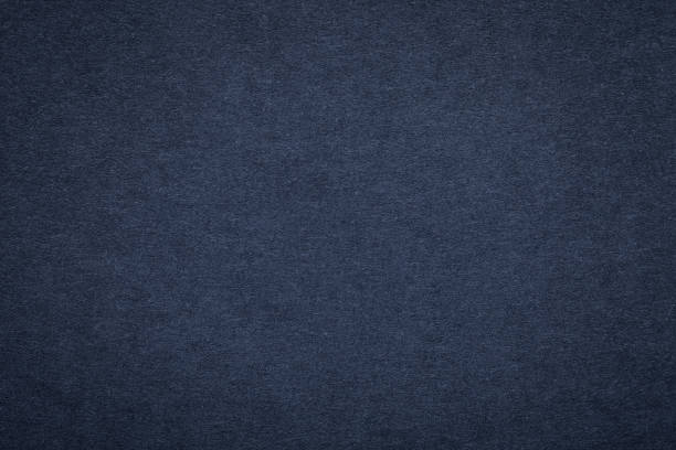 Texture of old navy blue paper background, closeup. Structure of dense dark denim cardboard - foto stock