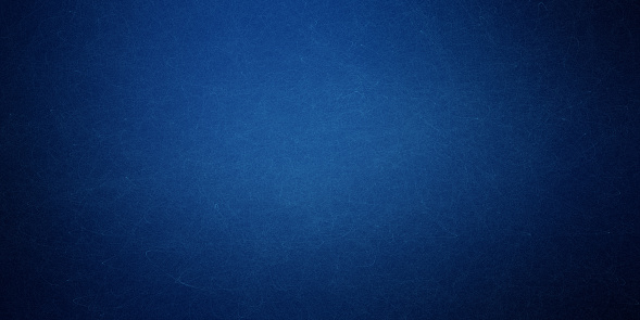 Texture of old navy blue paper closeup