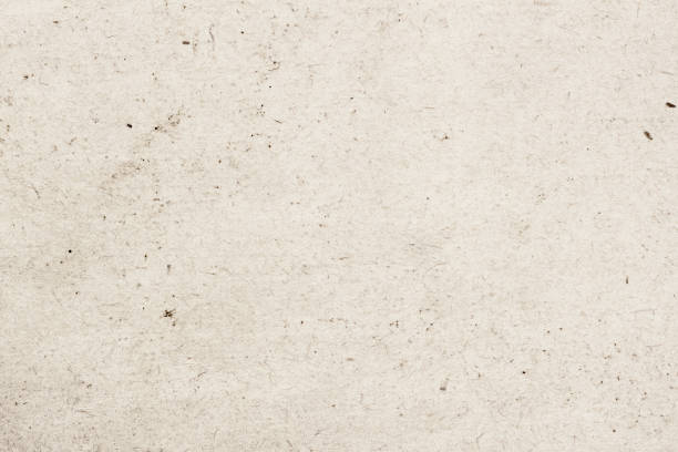 Texture of old organic light cream paper with wrinkles, background for design with copy space text, image. Recyclable material,with small inclusions of cellulose stock photo