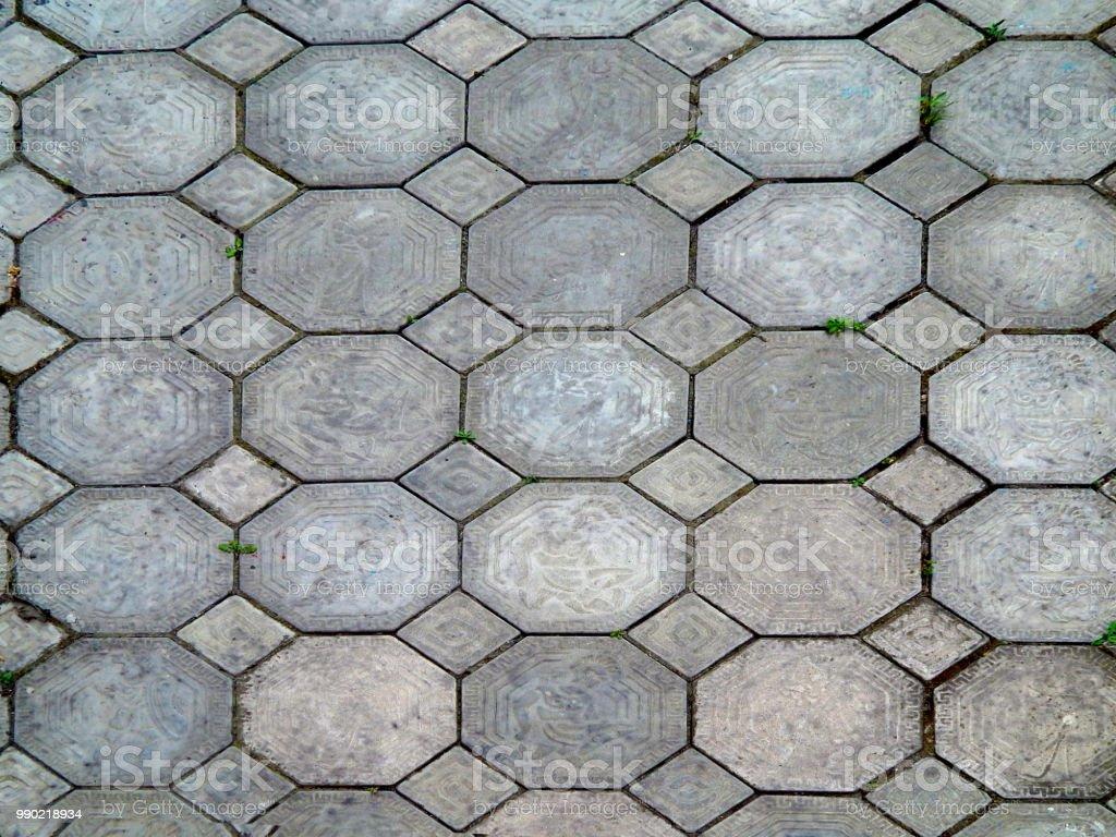 Het patroon van oude bestrating slab closeup rode oude tegels