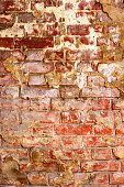 Texture of old red brick wall surface with cement and concrete seams