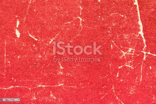 istock Texture of old red scratched and torn paper. Abstract background for design 927602980