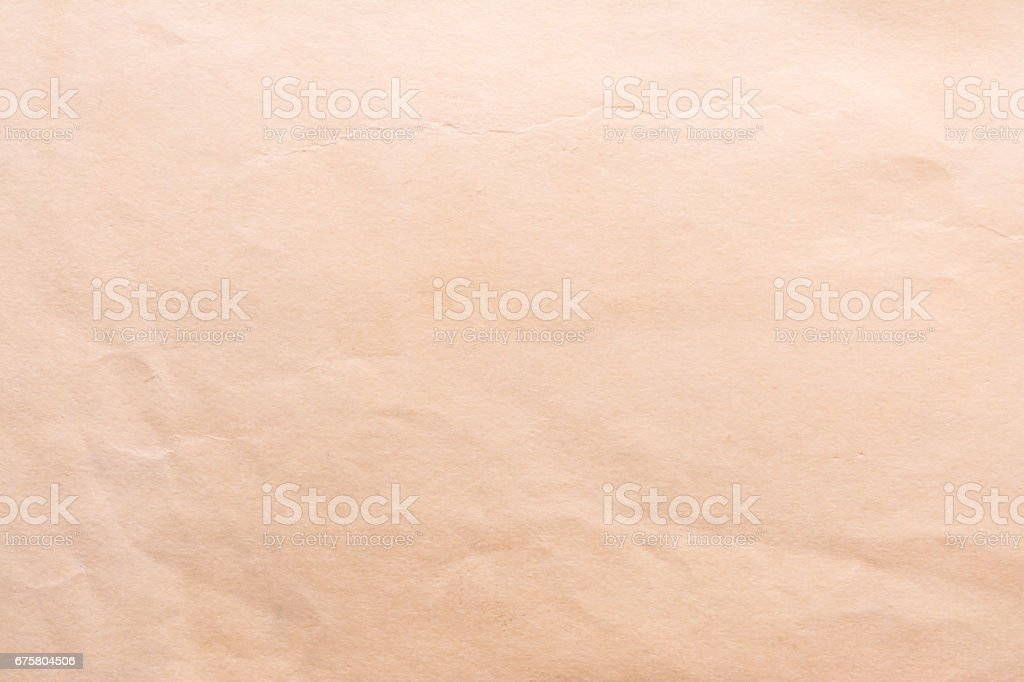 Texture of old shabby and crumpled paper area, vintage style, abstract close-up background stock photo