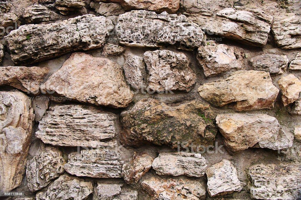 Texture of old stones and cobblestones of coral origin stock photo