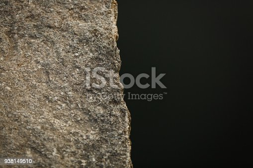 istock texture of old wall, stone on a black background 938149510