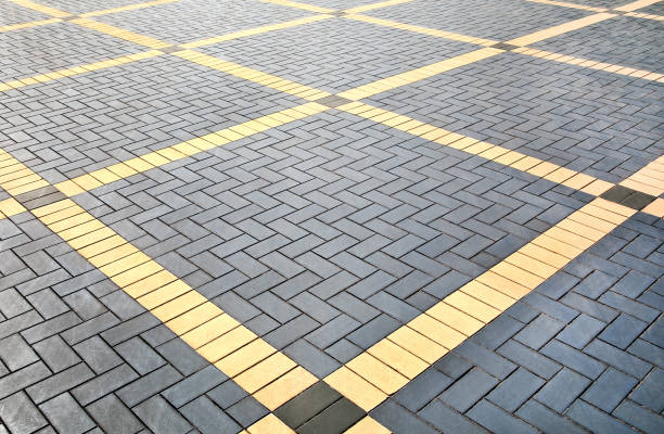Texture of  patterned paving tiles, perspective view. stock photo
