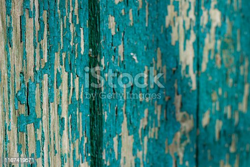 471504772 istock photo Texture of peeling green paint on the boards, vintage old 1167419571