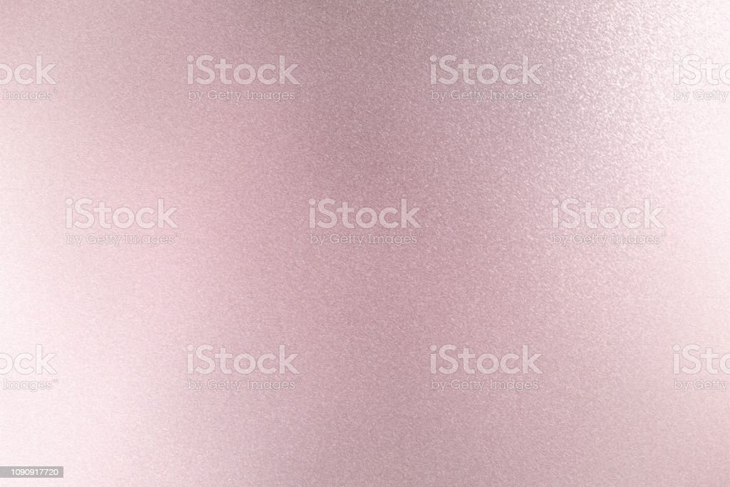 Texture of reflection on rough pink metallic wall, abstract background