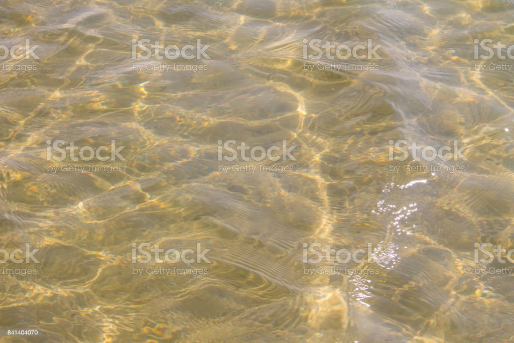 Texture of ripple sea water with sand bottom for background stock photo