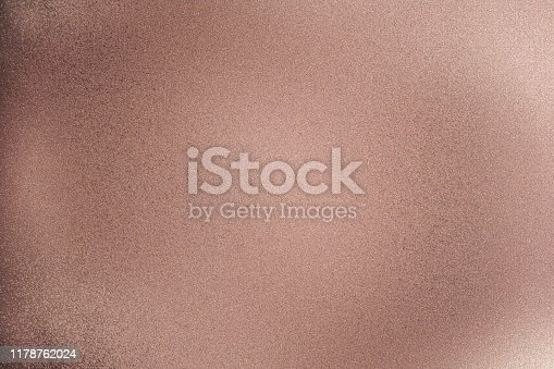 Texture of rose gold brushed metallic wall, abstract pattern background