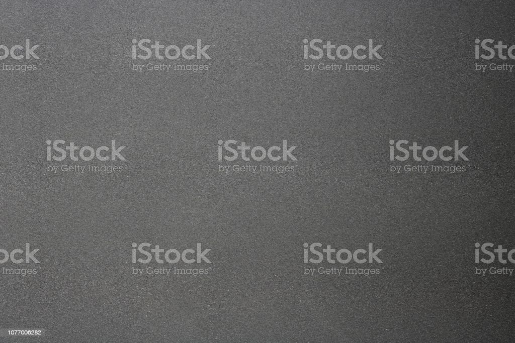 Texture of rough hard black steel panel, abstract background stock photo