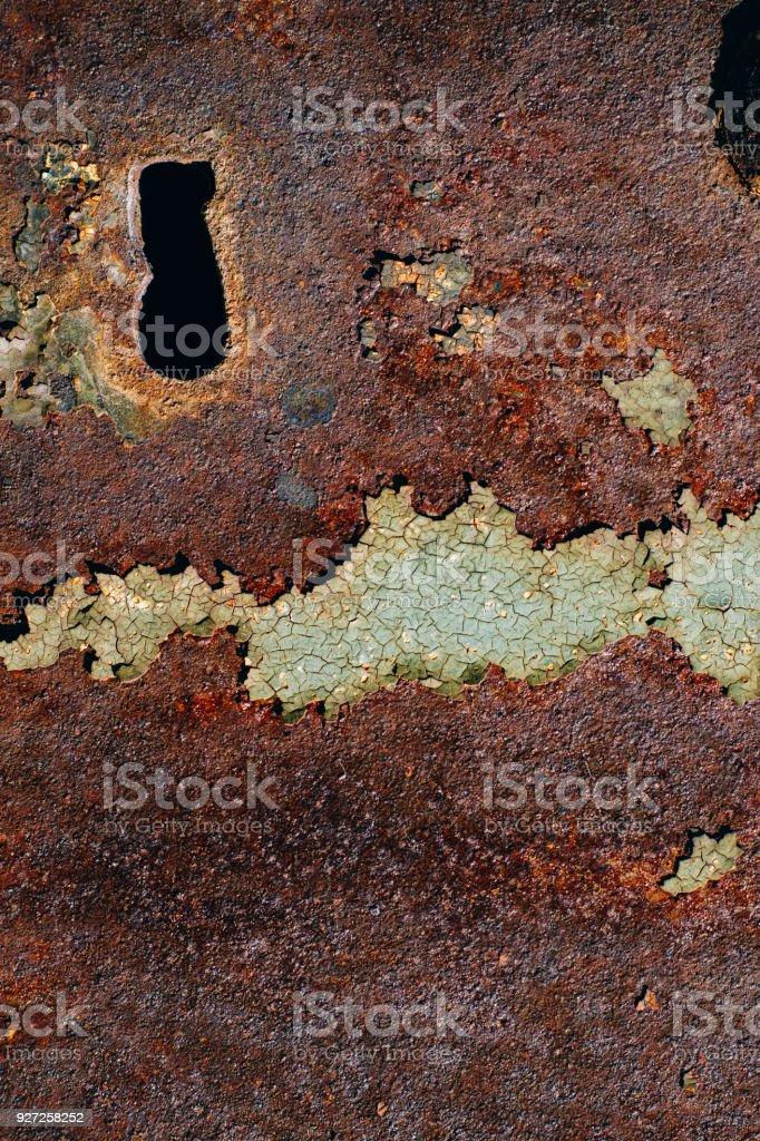 texture of rusty iron, cracked green paint on an old metallic...