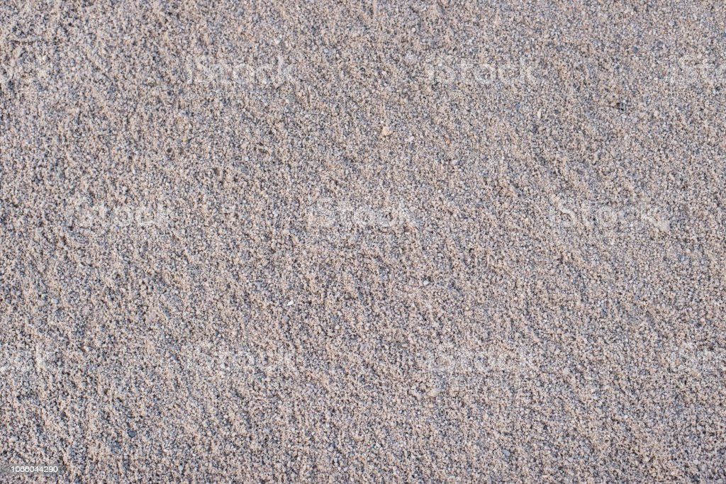 texture of sand and small pebble rocks in a construction area stock photo