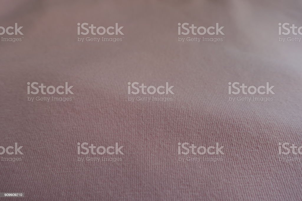 Texture of simple unprinted light pink fabric stock photo