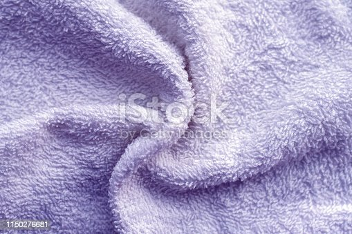 1151113068 istock photo Texture of soft tissue fibers. Close-up.Fluffy Gentle baby fabric with waves and folds. Soft pastel textile texture. Folds on the soft fabric. Rose towel terry cloth. 1150276681