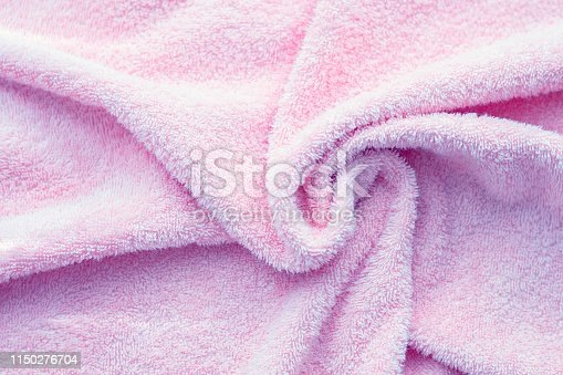 1151113068 istock photo Texture of soft tissue fibers. Close-up.Fluffy Gentle baby fabric with waves and folds. Soft pastel textile texture. Folds on the soft fabric. Rose towel terry cloth. 1150276704
