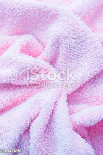 1151113068 istock photo Texture of soft tissue fibers. Close-up.Fluffy Gentle baby fabric with waves and folds. Soft pastel textile texture. Folds on the soft fabric. Rose towel terry cloth. 1150276989