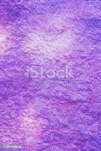 1151113068 istock photo Texture of soft tissue fibers. Close-up.Fluffy Gentle baby fabric with waves and folds. Soft pastel textile texture. Folds on the soft fabric. Rose towel terry cloth. 1150734978
