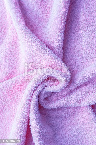 1151113068 istock photo Texture of soft tissue fibers. Close-up.Fluffy Gentle baby fabric with waves and folds. Soft pastel textile texture. Folds on the soft fabric. Rose towel terry cloth. 1150734979