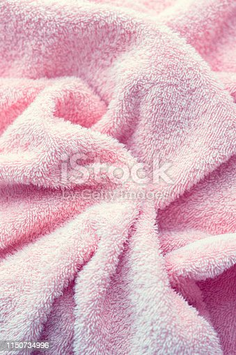 1151113068 istock photo Texture of soft tissue fibers. Close-up.Fluffy Gentle baby fabric with waves and folds. Soft pastel textile texture. Folds on the soft fabric. Rose towel terry cloth. 1150734996