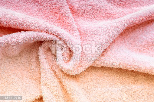 1151113068 istock photo Texture of soft tissue fibers. Close-up.Fluffy Gentle baby fabric with waves and folds. Soft pastel textile texture. Folds on the soft fabric. Rose towel terry cloth. 1151112710