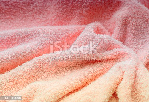 1151113068 istock photo Texture of soft tissue fibers. Close-up.Fluffy Gentle baby fabric with waves and folds. Soft pastel textile texture. Folds on the soft fabric. Rose towel terry cloth. 1151113068
