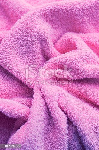 1151113068 istock photo Texture of soft tissue fibers. Close-up.Fluffy Gentle baby fabric with waves and folds. Soft pastel textile texture. Folds on the soft fabric. Rose towel terry cloth. 1152146179