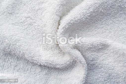 1151113068 istock photo Texture of soft tissue fibers. Close-up.Fluffy Gentle baby fabric with waves and folds. Soft pastel textile texture. Folds on the soft fabric. Rose towel terry cloth. 1152146314